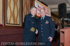 Fr. Chris Botti with Chief of Department Leonard.  Chris has been elected the 5th President of the Honor Legion