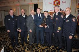 Fr. Dan Ward, BC Tom Richardson, Commissioner Sal Cassano, DC Vincent Dunn, Capt. John Feehan, Chief Edward Kilduff, Lt. Paul Mastronardi