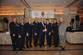 Captain Vigiano accepts Feehan Memorial Award (L-R) Fr. Ward,BC Gaetani, Lt. Mastronardi, Lt. Guinan, Capt. Vigiano, Capt. Feehan, Fr. Ducalo, Capt. Dowling